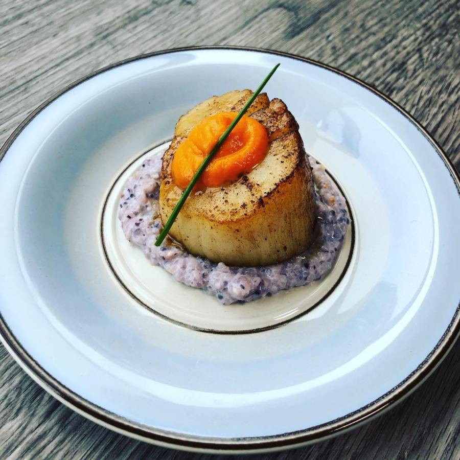 Sea Scallop, Ras el Hanout, Geechie Boy Mill Blue Grits, Whey, Harissa/Carrot Purée, Chive by frederick maryland personal chef and caterer chris spear