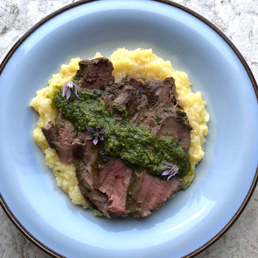 grilled lamb heart with herb chimichurri over polenta by frederick maryland personal chef and caterer chris spear